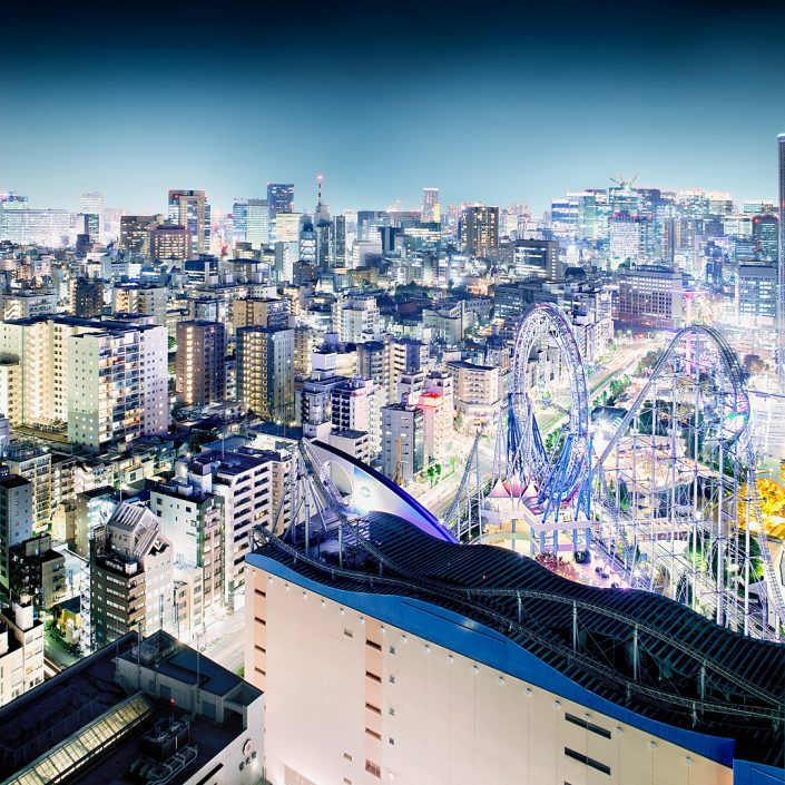 Awesome view over Tokyo with Rollercoaster, ferris wheel and skyline